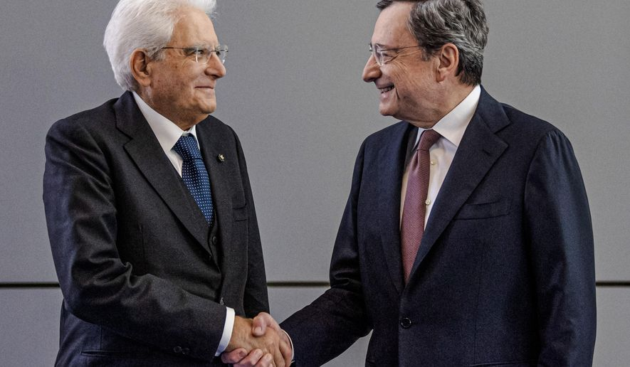 FILE-- Italy's President Sergio Mattarella, left, welcomes reigning European Central Bank President Mario Draghi on the eve of the change at the head of the ECB in Frankfurt, Germany, Monday, Oct. 28, 2019. Italian President Sergio Mattarella has summoned Tuesday, Feb. 2, 2021, former European Central Bank President Mario Draghi at the Quirinale Presidential Palace on Wednesday for talks, after two rounds of talks failed to seal an agreement among parties on a new premiership for the outgoing Giuseppe Conte. (Boris Roessler/Pool Photo via AP)
