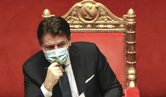 FILE - In this Tuesday, Jan. 19, 2021 file photo Premier Giuseppe Conte attends a debate at the Senate prior to a confidence vote, in Rome. The political parties that make up caretaker Premier Giuseppe Conte's collapsed government kept up their squabbling over key policy issues, including European Union pandemic aid, as they struggle to give birth to what would be a revived coalition. President Sergio Mattarella has set Tuesday Feb. 2, 2021 as the deadline for a progress report.  (AP Photo/Alessandra Tarantino, file)