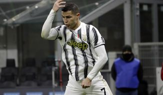 Juventus' Cristiano Ronaldo celebrates his side's first goal after scoring a penalty during the Italian Cup semi-final first leg soccer match between Inter Milan and Juventus at the San Siro stadium, in Milan, Italy, Tuesday, Feb. 2, 2021. (AP Photo/Luca Bruno)