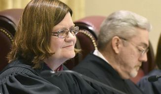 FILE - In this Feb. 24, 2016 file photo, Missouri Supreme Court Judge Laura Denvir Stith, left, sits on the bench at the Missouri Supreme Court building in Jefferson City, Mo. Stith is retiring. Stith on Tuesday, Feb. 2, 2021, said her last day will be March 8. She was appointed to the state Supreme Court in 2001 by former Democratic Gov. Bob Holden. She was the second woman appointed to the state high court. (Annie Rice/Missourian via AP, File)