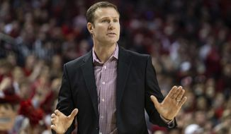 """FILE - In this Feb. 15, 2020, file photo, Nebraska head coach Fred Hoiberg gestures to players during the first half of an NCAA college basketball game against Wisconsin in Lincoln, Neb. The Nebraska men's basketball team is emerging from a shutdown because of a COVID-19 outbreak that left coach Hoiberg with the most severe case. """"I got a little scared, to be honest with you, just with everything I've had in my past with two open heart surgeries and being fully dependent on a pacemaker,"""" Hoiberg said Tuesday, FEb. 2, 2021.  (AP Photo/John Peterson, File)"""