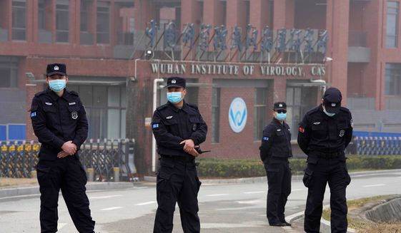Security personnel manned the entrance of the Wuhan Institute of Virology during a visit this week by a team from the World Health Organization. (Associated Press) **FILE**