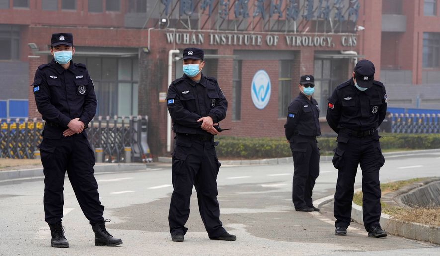 Security personnel manned the entrance of the Wuhan Institute of Virology during a visit this week by a team from the World Health Organization. (Associated Press)
