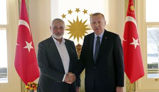 In this Feb. 1, 2020, file photo, Turkey's President Recep Tayyip Erdogan, right, shakes hands with Hamas movement chief Ismail Haniyeh, prior to their meeting in Istanbul. (Presidential Press Service via AP, Pool, File)