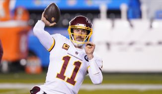 Washington Football Team quarterback Alex Smith warms up before an NFL football game against the Philadelphia Eagles in Philadelphia, in this Sunday, Jan. 3, 2021, file photo. Washingtons biggest offseason need is to figure out its quarterback situation. Trade for DeShaun Watson? Sign Cam Newton? Roll with Alex Smith and Kyle Allen? Coach Ron Rivera says nothing is off the table. (AP Photo/Chris Szagola, File) **FILE**