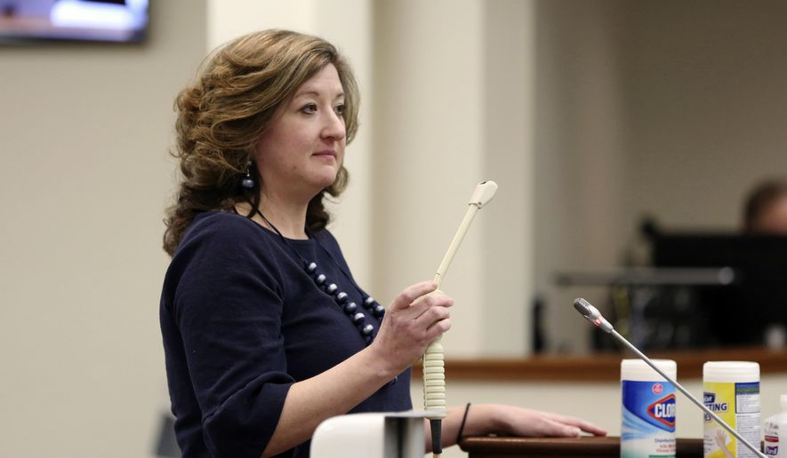 """Melissa Anne """"Mac"""" Cunningham-Sereque shows the wand used to do ultrasound on pregnant women during a South Carolina House subcommittee hearing on an abortion bill on Wednesday, Feb. 3, 2021, in Columbia, S.C. The bill would outlaw almost all abortions in the state. (AP Photo/Jeffrey Collins)"""