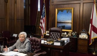 Alabama Gov. Kay Ivey holds a sit down interview with reporters in the Governor's office at the Alabama State Capitol Building in Montgomery, Ala., on Wednesday, Feb. 3, 2021. (Jake Crandall/The Montgomery Advertiser via AP)