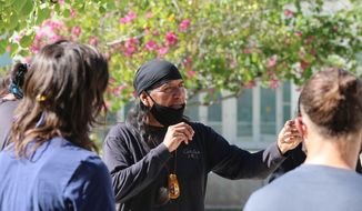 Former San Carlos Apache Chairman Wendsler Nosie Sr. talks to a group gathered outside the federal courthouse in Phoenix, Tuesday, Feb. 2, 2021. Nosie leads Apache Stronghold, a group that's asking a federal judge to keep the U.S. Forest Service from turning over a parcel of land it considers sacred, to a copper mining company. (AP Photo/Cheyanne Mumphrey)