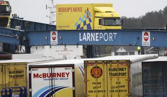 Vehicles disembark from the P&O ferry arriving from Scotland at the port of Larne, Northern Ireland, Tuesday, Feb. 2, 2021. Authorities in Northern Ireland have suspended checks on animal products and withdrawn workers from two ports after threats against border staff. (AP Photo/Peter Morrison)