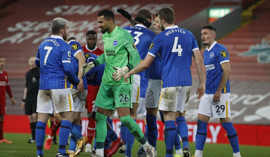 Brighton players celebrate at the end of the English Premier League soccer match between Liverpool and Brighton at Anfield stadium, in Liverpool, England, Wednesday, Feb. 3, 2021. Brighton won 1-0. (Phil Noble/Pool via AP)