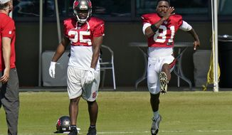 New Tampa Bay Buccaneers wide receiver Antonio Brown (81) runs along side running back LeSean McCoy (25) during an NFL football practice Thursday, Nov. 5, 2020, in Tampa, Fla. (AP Photo/Chris O'Meara)