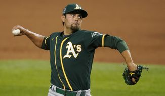 FILE - In this Friday, Sept. 11, 2020 file photo, Oakland Athletics relief pitcher Joakim Soria throws to the Texas Rangers in the ninth inning of a baseball game in Arlington, Texas. The Arizona Diamondbacks have agreed to terms on a one-year, $3.5 million deal with veteran relief pitcher Joakim Soria, according to a person with knowledge of the negotiations, Wednesday, Feb. 3, 2021. (AP Photo/Tony Gutierrez, File)