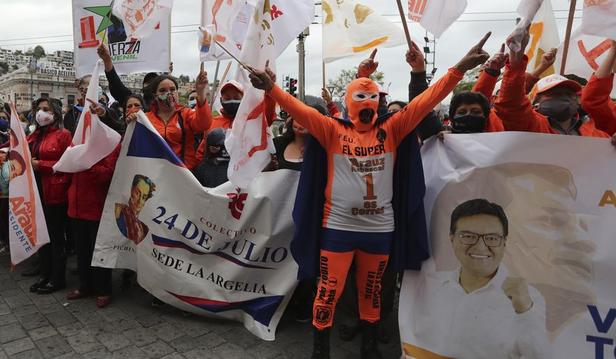 """Supporters of Andres Arauz, presidential candidate for the alliance """"Unidos por la Esperanza"""" and backed by former president Rafael Correa participate in a rally in Quito, Ecuador, Tuesday, Jan. 26, 2021. Ecuador will hold elections on Feb. 7. (AP Photo/Dolores Ochoa)"""
