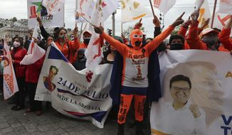 "Supporters of Andres Arauz, presidential candidate for the alliance ""Unidos por la Esperanza"" and backed by former president Rafael Correa participate in a rally in Quito, Ecuador, Tuesday, Jan. 26, 2021. Ecuador will hold elections on Feb. 7. (AP Photo/Dolores Ochoa)"