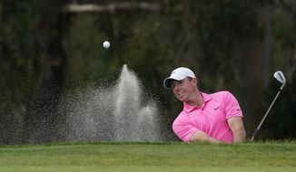 Rory McIlroy, of Northern Ireland, hits out of a bunker to the 13th green on the South Course during the final round of the Farmers Insurance Open golf tournament at Torrey Pines, Sunday, Jan. 31, 2021, in San Diego. (AP Photo/Gregory Bull)