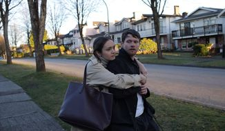 """This image provided by IFC Films shows Jack O'Connell as Jude, right, and Olivia Cooke as Emma in a scene from Chad Hartigan's """"Little Fish."""" (IFC Films via AP)"""
