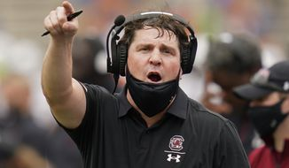 FILE - In this Saturday, Oct. 3, 2020 file photo, South Carolina head coach Will Muschamp has words with an official during the first half of an NCAA college football game against Florida in Gainesville, Fla. Former South Carolina coach Will Muschamp has accepted a position as an analyst on Kirby Smart's Georgia staff. Smart said Wednesday, Feb. 3, 2021 that Muschamp, also a former Florida coach, will focus on defense. (AP Photo/John Raoux, Pool, File)
