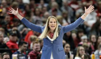 Maryland head coach Brenda Frese gestures during the second half of an NCAA college basketball semifinal game against Indiana at the Big Ten Conference tournament in Indianapolis, in this Saturday, March 7, 2020, file photo. Frese stands one victory away from tying Weller for most wins at Maryland, with No. 499 ripe to be plucked on Thursday, Feb. 4, 2021, when the 10th-ranked Terrapins (12-2, 8-1) host struggling Wisconsin (4-11, 1-11). (AP Photo/Darron Cummings) **FILE**