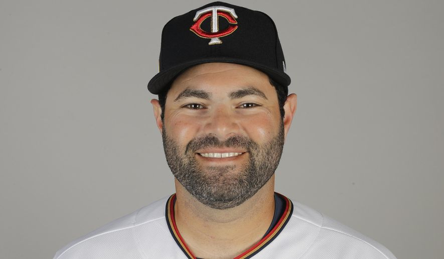 FILE - This is a 2020 file photo showing Alex Avila of the Minnesota Twins baseball team. Avila finalized a one-year agreement with the Washington Nationals on Wednesday, Feb. 3, 2021. The 34-year-old Avila is expected to be the primary backup to starting catcher Yan Gomes in Washington. (AP Photo/Brynn Anderson, File)