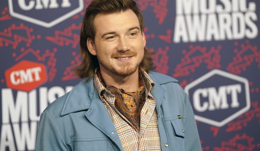 FILE - Morgan Wallen arrives at the CMT Music Awards in Nashville, Tenn. on June 5, 2019. Wallen has apologized after a video surfaced showed him shouting a racial slur.  The video, which was first published by TMZ on Tuesday night, showed him outside a home in Nashville, Tennessee yelling profanities. (AP Photo/Sanford Myers, File)