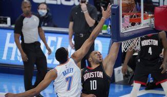 Houston Rockets guard Eric Gordon (10) shoots in front of Oklahoma City Thunder forward Darius Bazley (7) in the second half of an NBA basketball game Wednesday, Feb. 3, 2021, in Oklahoma City. (AP Photo/Sue Ogrocki)