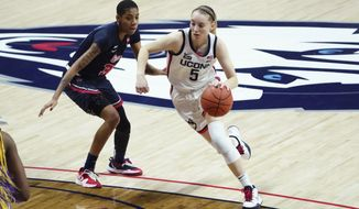 Connecticut guard Paige Bueckers (5) drives the ball against St. John's guard Kadaja Bailey (30) during the first half of an NCAA college basketball game Wednesday, Feb. 3, 2021, in Storrs, Conn. (David Butler II/Pool Photo via AP)
