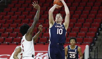 Virginia's Sam Hauser (10) shoots as North Carolina State's Dereon Seabron (1) defends during the first half of an NCAA college basketball game Wednesday, Feb. 3, 2021, in Raleigh, N.C. (Ethan Hyman/The News & Observer via AP, Pool)