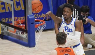 Pittsburgh's Xavier Johnson, right, shoots over Virginia Tech's Hunter Cattoor (0) during the first half of an NCAA college basketball game Wednesday, Feb. 3, 2021, in Pittsburgh. (AP Photo/Keith Srakocic)