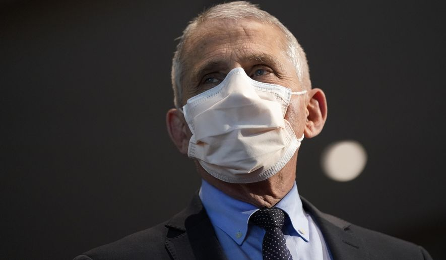 In this Dec. 22, 2020, file photo, Dr. Anthony Fauci, director of the National Institute of Allergy and Infectious Diseases, speaks before receiving his first dose of the COVID-19 vaccine at the National Institutes of Health, in Bethesda, Md.  (AP Photo/Patrick Semansky, Pool, File)