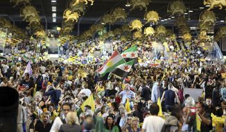 In this Friday, June 27, 2014 file photo, thousands of exiled Iranians gathered in Villepinte, north of Paris, to listen to the speech of Maryam Rajavi, the leader of Iran Mujahedeen-e-Khalq opposition group. An Iranian official on Thursday was convicted of masterminding a thwarted bomb attack against an exiled Iranian opposition group in France in 2018 and sentenced to 20 years in prison by a Belgian court that rejected his claim of diplomatic immunity. (AP Photo/Rermy de la Mauviniere, File)