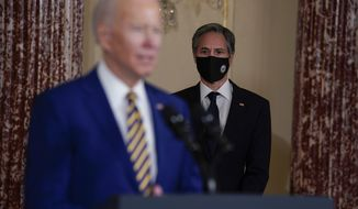 Secretary of State Antony Blinken listens as President Joe Biden delivers a speech on foreign policy, at the State Department, Thursday, Feb. 4, 2021, in Washington. (AP Photo/Evan Vucci)