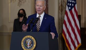Vice President Kamala Harris, left, looks on as President Joe Biden delivers a speech on foreign policy, at the State Department, Thursday, Feb. 4, 2021, in Washington. (AP Photo/Evan Vucci)