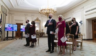 In this Jan. 21, 2021, file photo, Doug Emhoff, left, Vice President Kamala Harris, President Joe Biden, and first lady Jill Biden, stand during a performance of the national anthem during a virtual Presidential Inaugural Prayer Service, in the State Dinning Room of the White House in Washington. Biden is expected to address the National Prayer Breakfast, a Washington tradition that calls on political combatants to set aside their differences for one morning. (AP Photo/Alex Brandon)