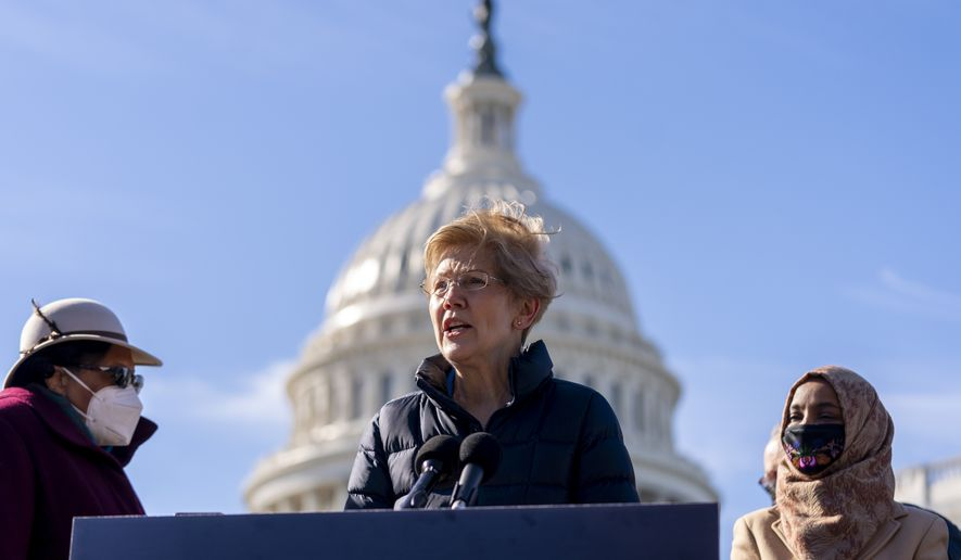 Sen. Elizabeth Warren, D-Mass., center, accompanied by Rep. Alma Adams, D-N.C., left, and Rep. Ilhan Omar, D-Minn., right, speaks at a news conference on Capitol Hill in Washington, Thursday, Feb. 4, 2021, about plans to reintroduce a resolution to call on President Joe Biden to take executive action to cancel up to $50,000 in debt for federal student loan borrowers. (AP Photo/Andrew Harnik)