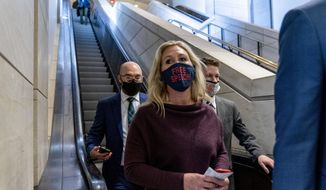 Rep. Marjorie Taylor Greene, R-Ga., goes back to her office after speaking on the floor of the House Chamber on Capitol Hill in Washington, Thursday, Feb. 4, 2021. (AP Photo/Andrew Harnik)