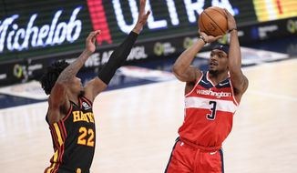 Washington Wizards guard Bradley Beal (3) shoots against Atlanta Hawks guard Cam Reddish (22) during the second half of an NBA basketball game, Friday, Jan. 29, 2021, in Washington. (AP Photo/Nick Wass)