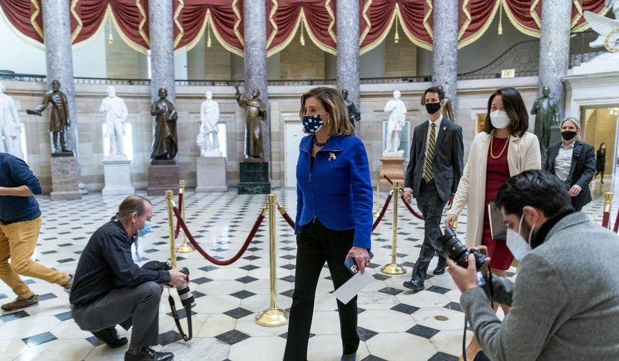 House Speaker Nancy Pelosi of Calif. walks to the House Chamber on Capitol Hill in Washington, Thursday, Feb. 4, 2021. (AP Photo/Andrew Harnik)