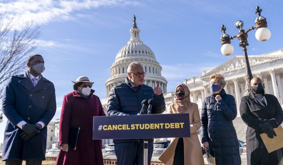 Senate Majority Leader Sen. Chuck Schumer of N.Y., center, accompanied by from left, Rep. Mondaire Jones, D-N.Y., D-Mass., Rep. Alma Adams, D-N.C., Rep. Ilhan Omar, D-Minn., Sen. Elizabeth Warren, D-Mass., and Rep. Ayanna Pressley, speaks at a news conference on Capitol Hill in Washington, Thursday, Feb. 4, 2021, about plans to reintroduce a resolution to call on President Joe Biden to take executive action to cancel up to $50,000 in debt for federal student loan borrowers. (AP Photo/Andrew Harnik) ** FILE **