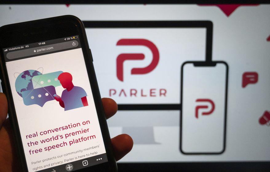 In this Jan. 10, 2021, photo, the website of the social media platform Parler is displayed in Berlin. (Christophe Gateau/dpa via AP) ** FILE **