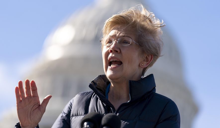 Sen. Elizabeth Warren, D-Mass., speaks at a news conference on Capitol Hill in Washington, Thursday, Feb. 4, 2021, about plans to reintroduce a resolution to call on President Joe Biden to take executive action to cancel up to $50,000 in debt for federal student loan borrowers. (AP Photo/Andrew Harnik) ** FILE **