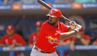 FILE - in this March 11, 2020, file photo, St. Louis Cardinals' Dexter Fowler waits for a pitch from New York Mets pitcher Jacob deGrom during the first inning of a spring training baseball game in Port S. Lucie, Fla. The Los Angeles Angels have acquired veteran outfielder Fowler from the Cardinals for cash or a player to be named later. The clubs announced the deal Thursday, Feb. 4, 2021. (AP Photo/Julio Cortez, File)