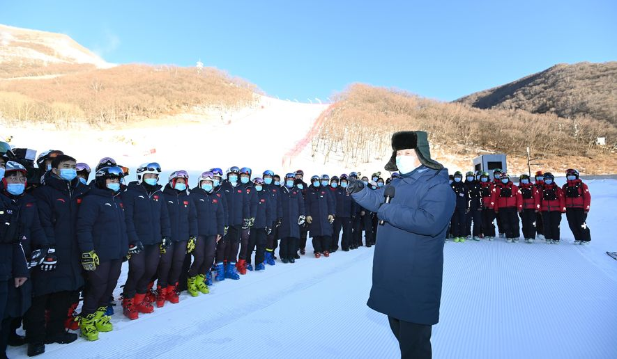 """FILE - In this Jan. 18, 2020, file photo released by China's Xinhua News Agency, Chinese President Xi Jinping speaks with athletes and coaches at the National Alpine Skiing Center in Yanqing on the outskirts of Beijing during a tour of venues and preparations for the 2022 Beijing Winter Olympics. The 2022 Beijing Winter Olympics will open a year from now. Most of the venues have been completed as the Chinese capital becomes the first city to hold both the Winter and Summer Olympics. Beijing held the 2008 Summer Olympics. But these Olympics are presenting some major problems. They are already scarred by accusations of rights abuses including """"genocide""""against more than 1 million Uighurs and other Muslim ethnic groups in western China. (Ju Peng/Xinhua via AP, File)"""