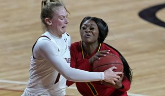 Boston College guard Cameron Swartz (1) and Louisville guard Dana Evans (1) compete for possession of the ball in the first half of an NCAA college basketball game, Thursday, Feb. 4, 2021, in Boston. (AP Photo/Elise Amendola)