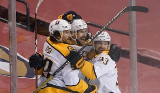 Nashville Predators defenseman Roman Josi (59) and right wing Viktor Arvidsson (33) celebrate with left wing Filip Forsberg, center, after Forsberg scored the winning goal during an overtime period of an NHL hockey game against the Florida Panthers, Thursday, Feb. 4, 2021, in Sunrise, Fla. (AP Photo/Wilfredo Lee)