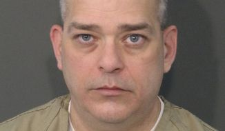 This undated photo provided by the Franklin County Ohio Sheriff's Department shows Adam Coy. The former Columbus Police officer was charged with murder Wednesday, Feb. 3, 2021, in the latest fallout following the December shooting death of 47-year-old Andre Hill, a Black man, the state's attorney general said.  (Franklin County Ohio Sheriff's Department via AP)