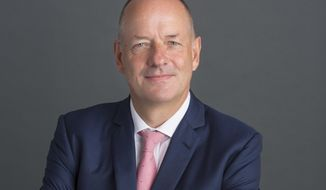 This photo provided by UnitedHealth Group shows Sir Andrew Witty.  UnitedHealth Group is promoting former GlaxoSmithKline leader Sir Andrew Witty to become the health insurance provider's next CEO immediately. The company said Thursday, Feb. 4, 2021 that current CEO David Wichmann will retire, more than three years after being promoted from his role as company president.(Richard Fleischman/UnitedHealth Group via AP)