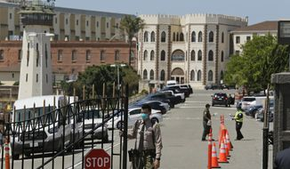 FILE - In this July 9, 2020, file photo, a correctional officer closes the main gate at San Quentin State Prison in San Quentin, Calif. California workplace safety officials announced Thursday, Feb. 4, 2021, that San Quentin rocked by one of the nation's worst coronavirus outbreaks has been hit with by far its largest pandemic-related fine yet against an employer. The $421,880 fine is several times higher than any others levied by the Division of Occupational Safety and Health, commonly known as Cal/OSHA. Only a few others exceed $100,000 and most are a few thousand dollars. (AP Photo/Eric Risberg, File)