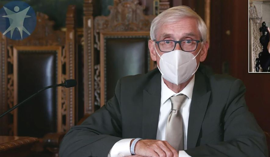This July 30, 2020, image taken from video by the Wisconsin Department of Health Services shows Wisconsin Gov. Tony Evers in Madison, Wis. Wisconsin's Republican-controlled Legislature has repealed Democratic Gov. Evers' statewide mask mandate Thursday, Feb. 4, 2021. Health experts have warned against repealing the mandate, saying masks are probably the most effective way to slow the spread of COVID-19. (Wisconsin Department of Health Services via the AP, File)