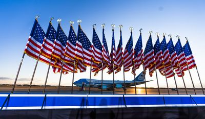 Air Force One is prepared for President Donald Trump as flags fly on a stage at Andrews Air Force Base, Md., Wednesday, Jan. 20, 2021. (AP Photo/Manuel Balce Ceneta) **FILE**