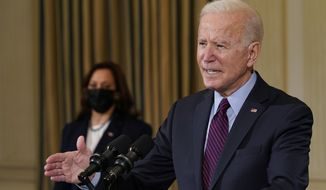President Joe Biden, accompanied by Vice President Kamala Harris, speaks about the economy in the State Dinning Room of the White House, Friday, Feb. 5, 2021, in Washington. (AP Photo/Alex Brandon)